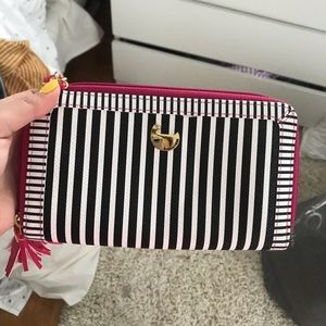 Black and white pink striped wallet with strap
